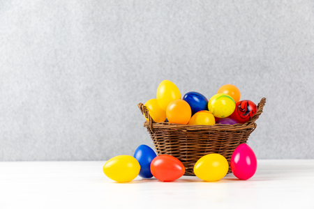 colorful easter eggs in a nest and gray background with copy space