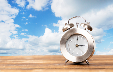 clock for summer time change with copy space and cloud background Reklamní fotografie