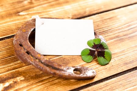 horseshoe with green shamrock sign for luck for st patricks day on a wooden background Reklamní fotografie - 123085154