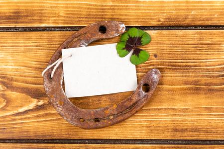 horseshoe with green shamrock sign for luck for st patricks day on a wooden background Reklamní fotografie - 123085155