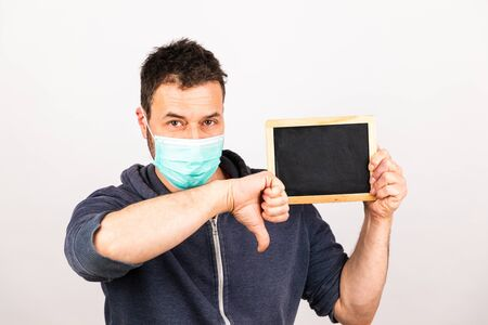 man with a mouthguard isolated against white background with blackboard