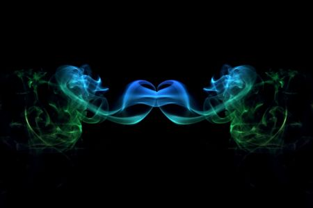 mirror image of coloured smoke trails Stock Photo