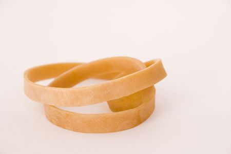 rubberband: single curled up rubberband isolated on a white background