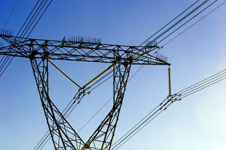 electric power lines and tower against blue clear sky Stock Photo