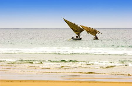 two traditional arabic fishing dhows  in Mozambique Stock Photo