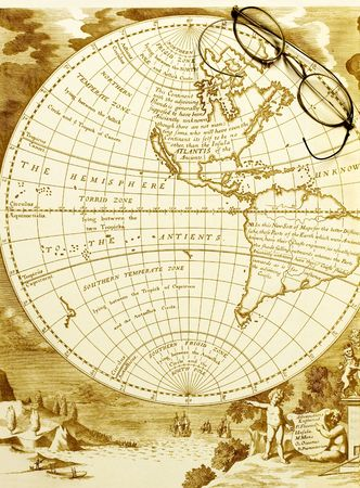 antique map of the western hemisphere with old spectacles