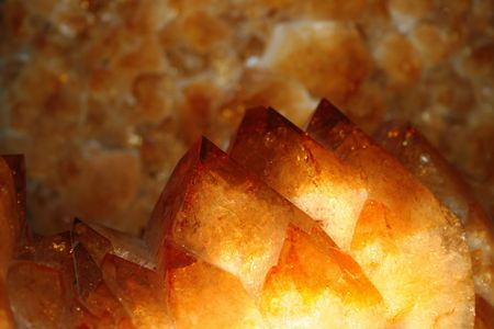 closeup of orange yellow citrine crystals with selective focus on foreground