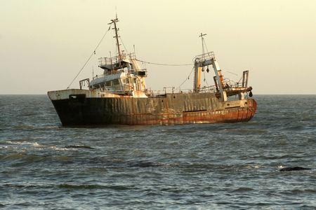 ship wreck: shipwreck at sunset in ocean