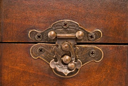 closeup of wooden treasure chest latch
