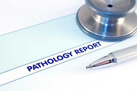 Pathology report,stethoscope and pen