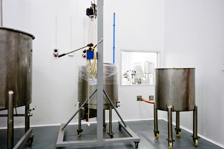 stainless steel tanks holding raw materials for manufacturing of pharmeceuticals