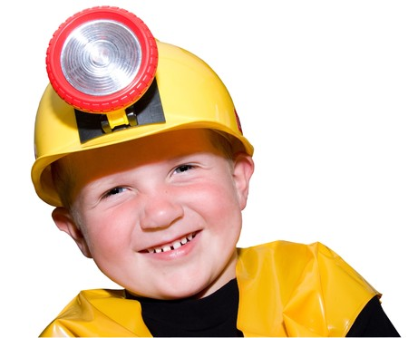 headlamp: laughing young boy with toy hardhat and headlamp making eye contact with camera isolated on white