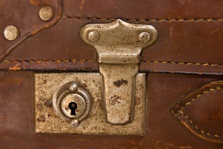 closeup of latch of old leather suitcase