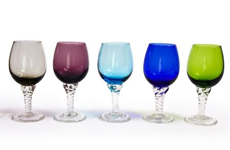 five colored sherry glasses in a row on white background,clipping photo