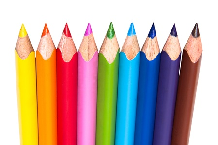nine colored pencils in a row isolated on white