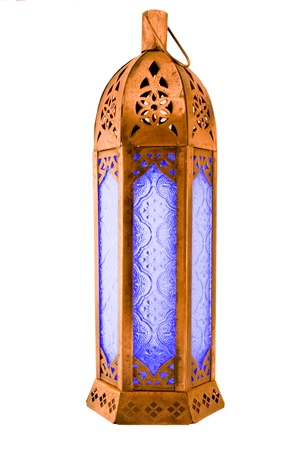 moroccan style roughly textured copper lantern with blue patterned glass for holding a candle, isolated on white,with clipping path photo