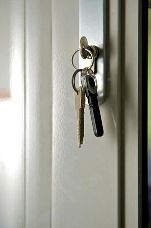 it put door with glass c by keys in the lock Stock Photo