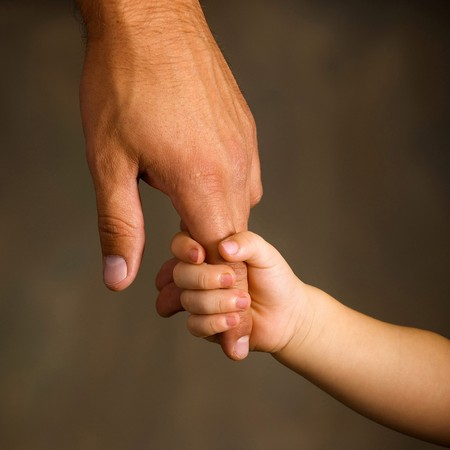grandfathers: Daughter holds the hand of the father