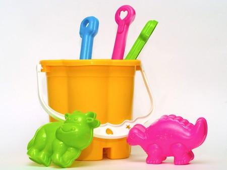 Colored toys for the game in the sand on the beach Stock Photo