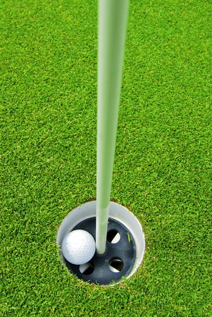 Game in the golf club against the background of the green juicy grass Stock Photo