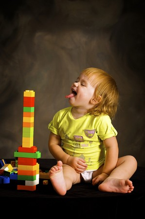 Small girl plays with the designer Stock Photo