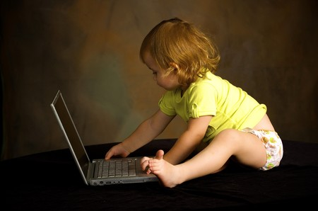 Small girl works with the computer Stock Photo - 4042194