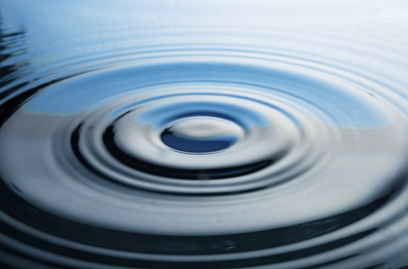 The round transparent drop of water, falls downwards photo