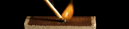 The wooden match is lighted from a box photo