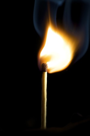 Wooden match burning on a black background Stock Photo - 4048146