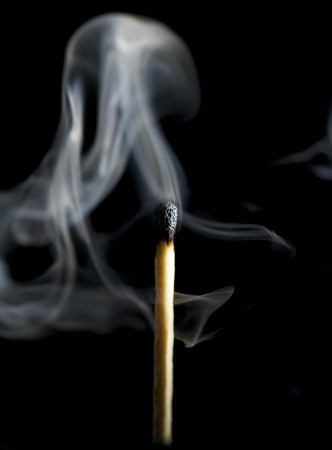 Wooden match burning on a black background Stock Photo - 4048151