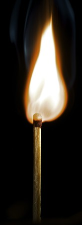 Wooden match burning on a black background Stock Photo - 4048148