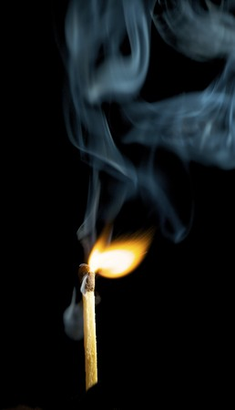 Wooden match burning on a black background Stock Photo - 4048150