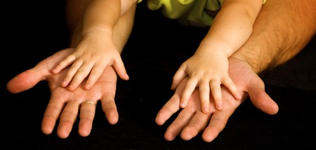 Daughter holds the hand of the father Stock Photo - 4091475