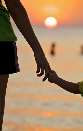 The small daughter holds mum by the hand on a decline