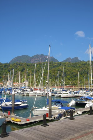 Landing stage with yachts standing on an anchor, Langkawi, Malaysia