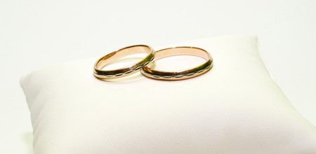 fragments: two golden rings on white close up shoot