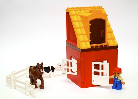 A series, life of plastic toys, the childrens designer, a farm Stock Photo