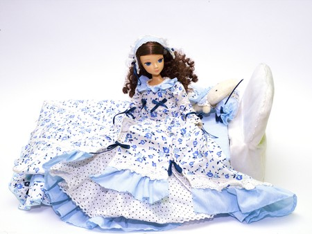 Collection doll in a blue dress