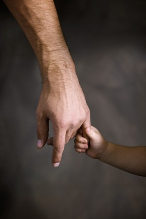 trust people: Daughter holds the hand of the father