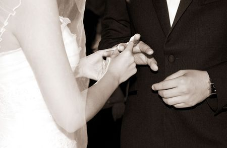 bride and groom changing wedding rings photo