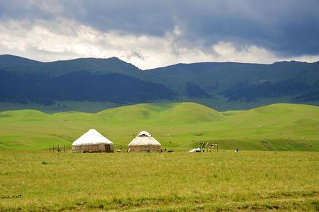 The Kazakh dwelling in mountains Yurta Stock Photo