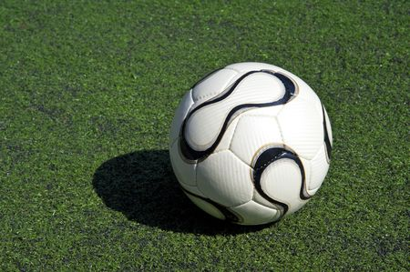 football or soccer ball on the grass Stock Photo