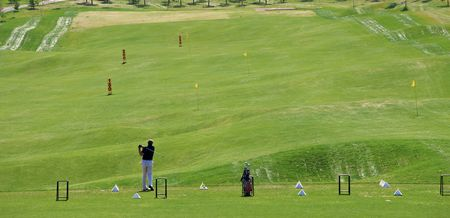 Game in the golf club against the background of the green juicy grass photo