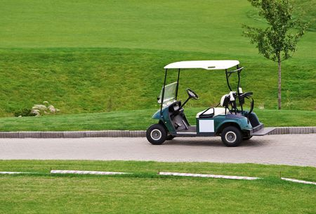 The car for transportation of people playing a golf photo