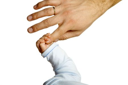 A childs hand holding an adults finger  photo