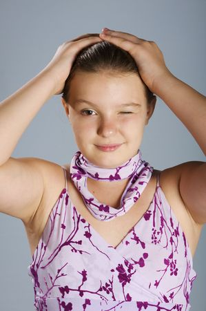 The young girl keeps for a head having blinked eyes Stock Photo - 6256750