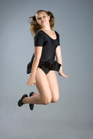 sport style girl in black swimsuit jumping photo