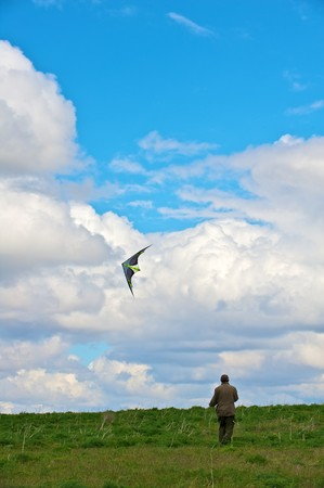 A Man flying his kite at the steppe photo