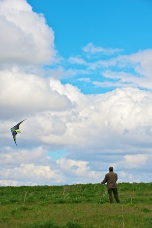 A Man flying his kite at the steppe
