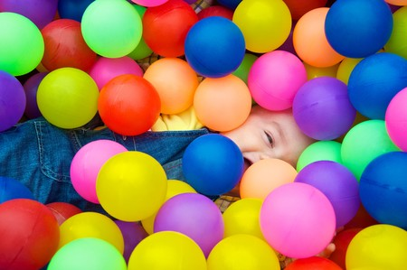 Happy kid playing in the colorful balls Stock Photo - 6997760
